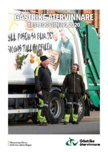 Två av Gästrike återvinnares chaufförer står framför en sopbil. På sopbilen står det Fyll påsen så blir det biogas till sopbilen.